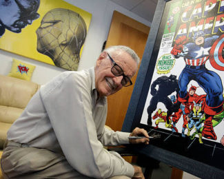 Stan Lee was part of the most important creative tandem in the history with Jack Kirby. Lee was writer, Kirby was artists, and their partnership produced the x?men, fantastic four, thor, hulk, magneto, the silver surfer and scores of other characters that have reached the movie screen or will soon. He is pictured here signing poster for an upcoming exhibit in his Beverly Hills office Sept. 15, 09.  (Photo by Barbara Davidson/Los Angeles Times via Getty Images)